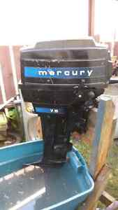7.5 HP 2 stroke  Mercury outboard motor with fuel tank and hose.