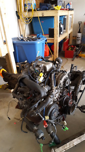 TWO 13b N/A  rotary engines and a 5 speed tranny