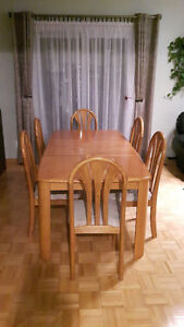Solid wood dining room table and charirs
