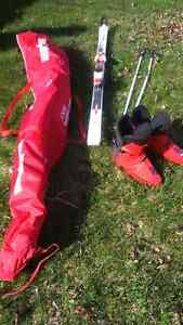 Skiis boots and poles for sale