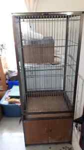 large cage with bottom cabinet