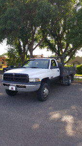 2002 dodge 3500 with 12 foot deck. $9500.00