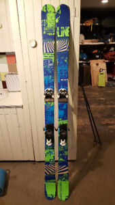 Twin tip all mountain skis with bindings, poles and helmet