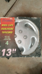 "BRAND NEW never used 13"" hubcaps. (33 cm)"