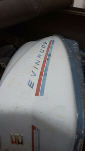 Evinrude 40 hp  motor for parts call with what you need