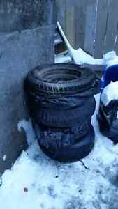 Winter tires with rims and bags