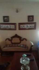 antique loveseat and side board