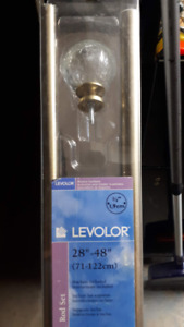 "Levelor Curtain rod - 28"" to 48"" with glass finials."