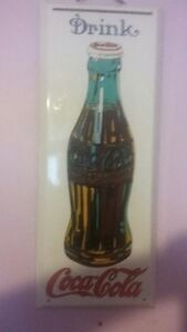 coca cola porclin sign and advertizing