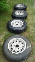 "Four 15"" rims and tires. Rims fit five bolt Chev/GMC truck, van."