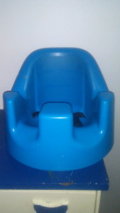 Blue bumbo chair with seat belt