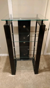 "Glass shelving unit with black metal frame 46"" tall"