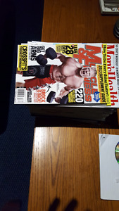 big stack of men's health , and muscle and fitness