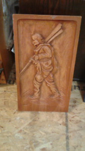 acadian fisherman wood carving