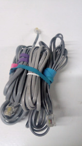 Six telephone extension cables.