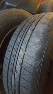 set of 4 tires on rims 175.65.R14
