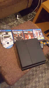Ps4 500gb 5 games and black and orange controller