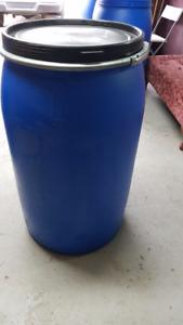 Large plastic 55 gallon shipping/storage barrels