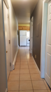 2 Bedroom Uptown Condo - Includes Lights, Heat + Private Parking