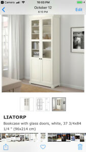 """Two Ikea """"Liatorp"""" Bookcase's with Glass"""