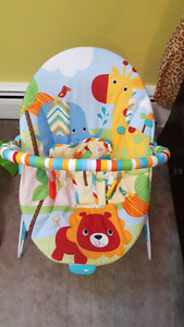 Vibrating baby chair w/ toys