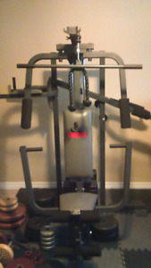 Weider universal gym, bench, and free weights