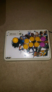 SELLING A MODDED MAD CATZ FIGHT STICK WITH GENUINE SANWA PARTS.
