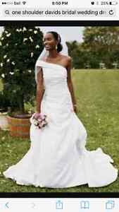 Size 12 wedding dress. Never worn or altered. From Davids bridal