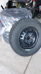 Motomaster Total Terrain snow tires on rims 225/70/16