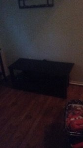 Glass tv stand with storage in it