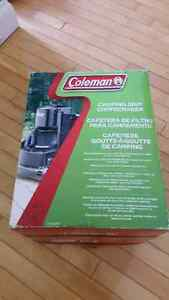 Coleman coffee maker.