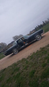 1966 LINCOLN WITH SUICIDE DOORS