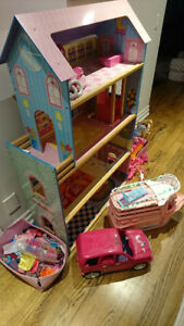 Doll house with furniture, barbies, clothing, boat, car, scooter