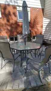 Glass table with 6 chairs/umbrella and stand