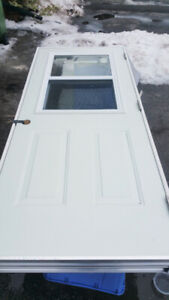 Right hand outswing exterior door with window