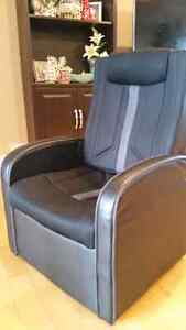 Black gaming chair with storage and ottoman