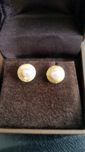 Pearl with gold studs