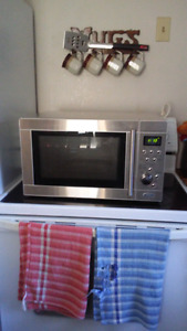 Rca microwave grilling oven 1450 input pover 1000 output power
