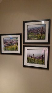 Three framed photos of rural Italy.