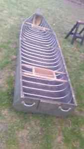 Flatback canoe and motor