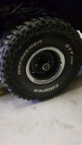 """35""""x12.5x15 cooper discovery tires on 6 bolt Chev rally wheels."""