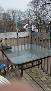 square glass patio table and 4 fold up chairs for ......... SOLD