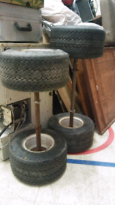 TWO AXLES WITH RIMS AND 4 NEW TIRES