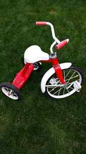 Boy or girl's red tricycle