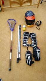 Lacrosse equipment- helmet, gloves, elbow pads, stick, 2 shafts