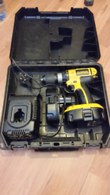 Dewalt DC725 cordless drill with two batteries, charger and the case g
