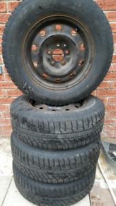 4 continental tires with rims 215/70/R15