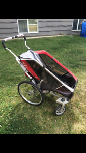 Single chariot stroller with bike attachment