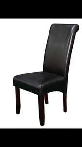 Four black faux leather dining chairs