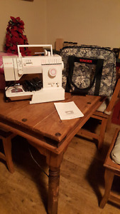 Singer sewing machine and canvas carrying case/storage